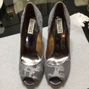 Beautiful Silve color shoes. Discounted at 20%.